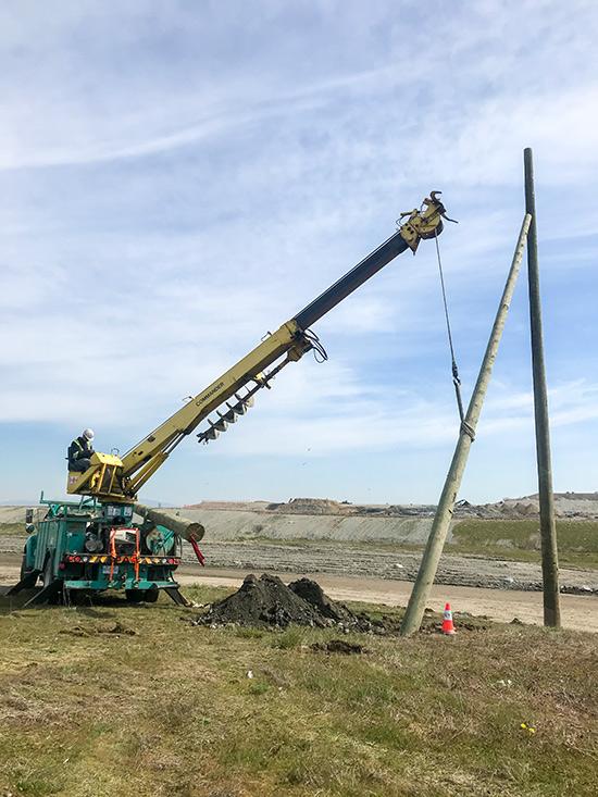 Installing a 40' push brace onto a 45' pole.