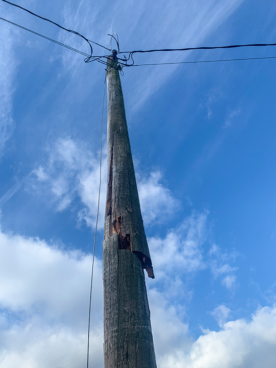 This old pole in Mission snapped in half. We replaced it with a new 35' treated pole and transferred the electrical wires from the old pole to the new pole