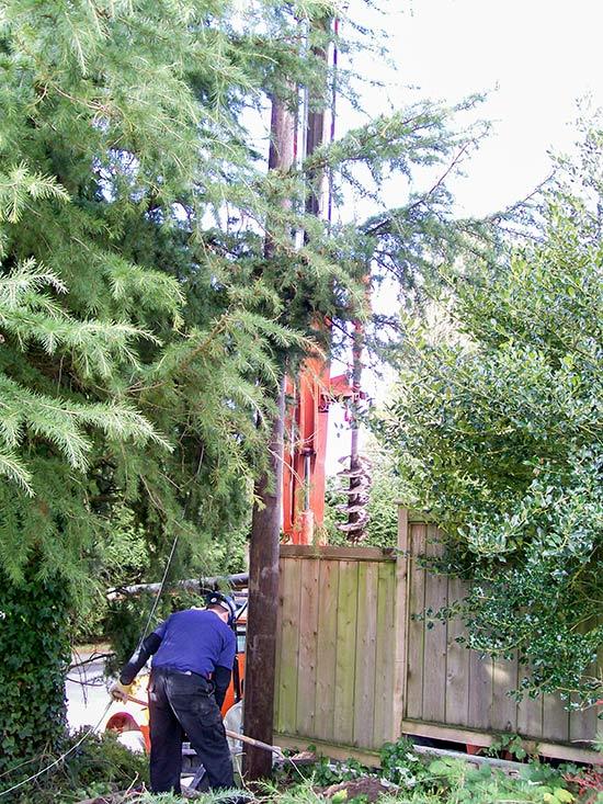 Setting a pole over a fence